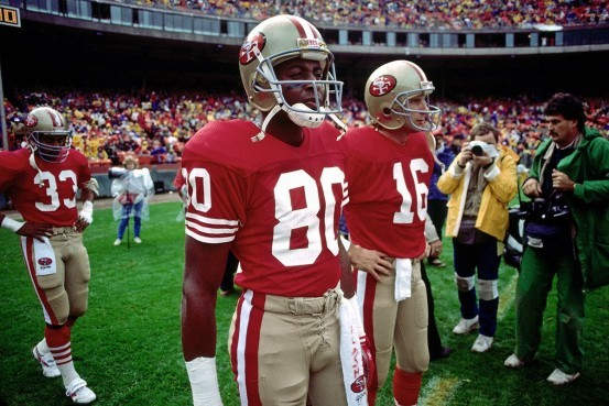 San Francisco 49ers quarterback Joe Montana (16) and wide receiver Jerry Rice (80) wait to take the field during an NFL game against the Los Angeles Raiders, Sunday, Nov. 13, 1988 in San Francisco. The Raiders won the game, 9 to 3. (AP Photo/Greg Trott)