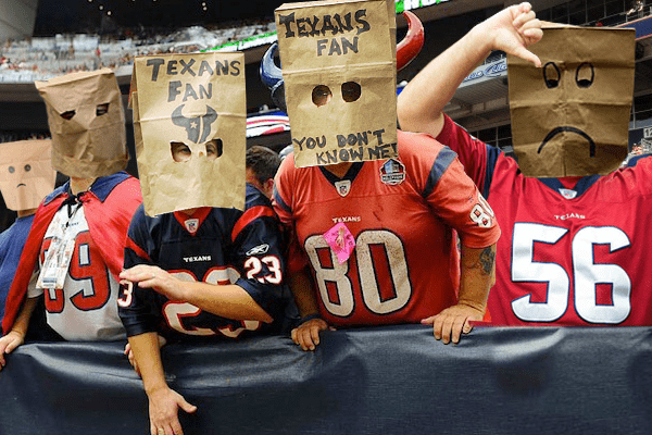SAD-HOUSTON-TEXANS-FANS-WEARING-BAGS-ON-THEIR-HEADS