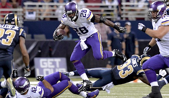 Minnesota Vikings Adrian Peterson jumps over St. Louis Rams E.J. Gaines during the fourth quarter at Edward Jones Dome in St. Louis  on September 7, 2014. (Pioneer Press: Sherri LaRose-Chiglo)