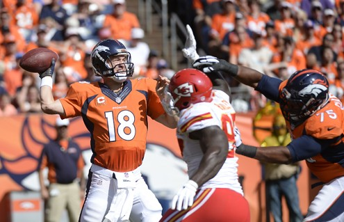 DENVER, CO - SEPTEMBER 14: Quarterback Peyton Manning (18) of the Denver Broncos makes a pass under pressure in the first quarter. The Denver Broncos played the Kansas City Chiefs at Sports Authority Field at Mile High in Denver, Colo. on September 14, 2014. (Photo by John Leyba/The Denver Post)